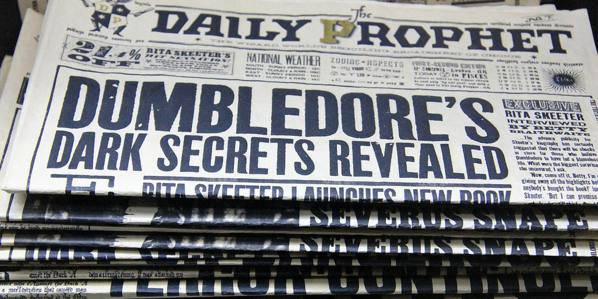 "Newspaper from Happy Potter with headline that reads ""Dumbledore's dark secret revealed"""