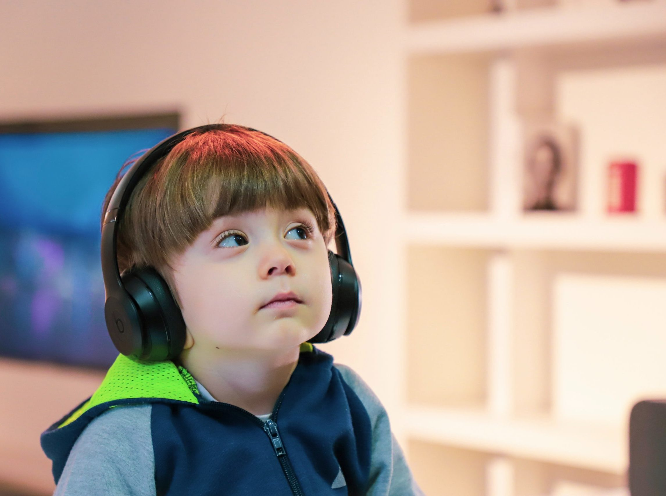 Young disabled boy with headphones