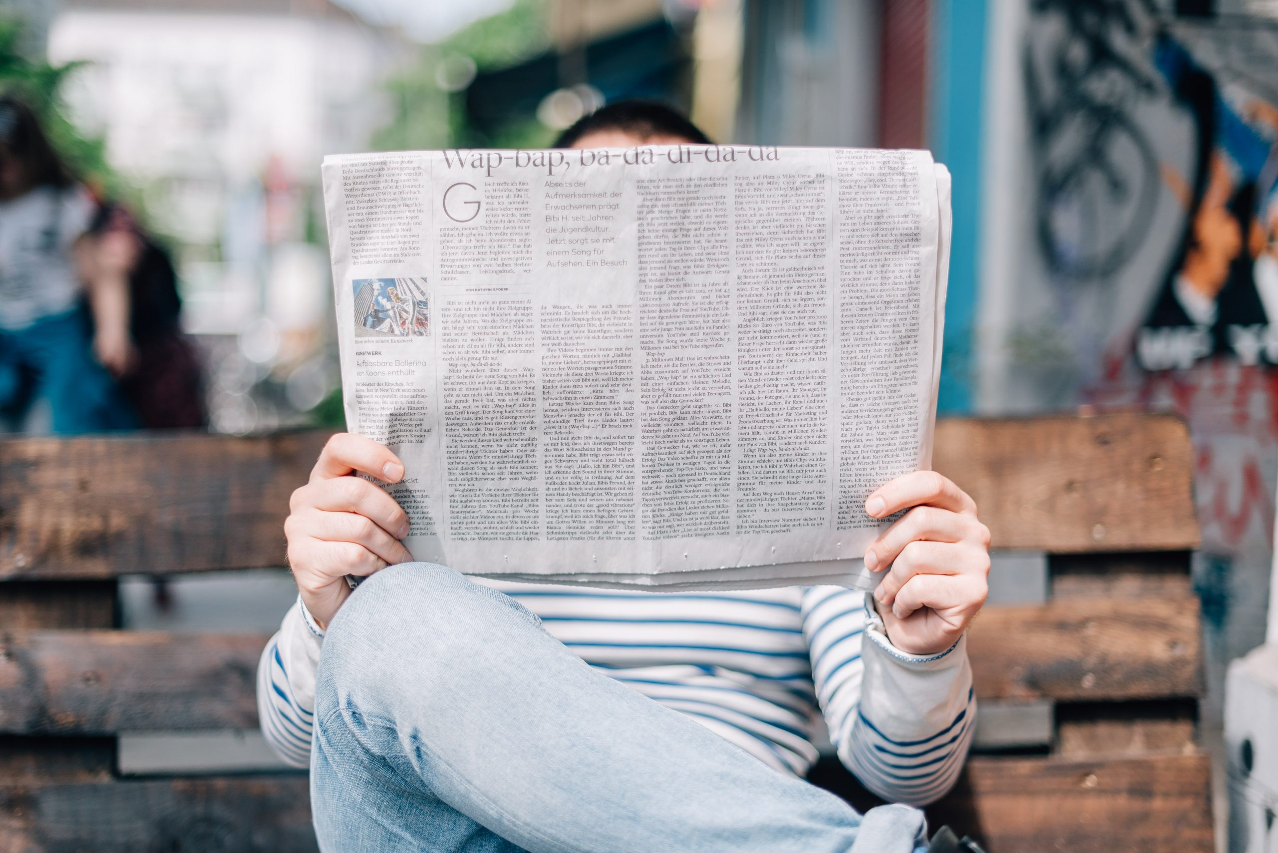 man reading newspaper to illustrate post on copywriting