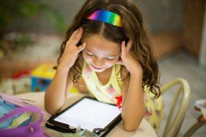 A girl watching an Ipad