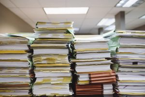 Piles of bookmarked files and books