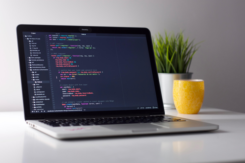 Laptop showing data through code