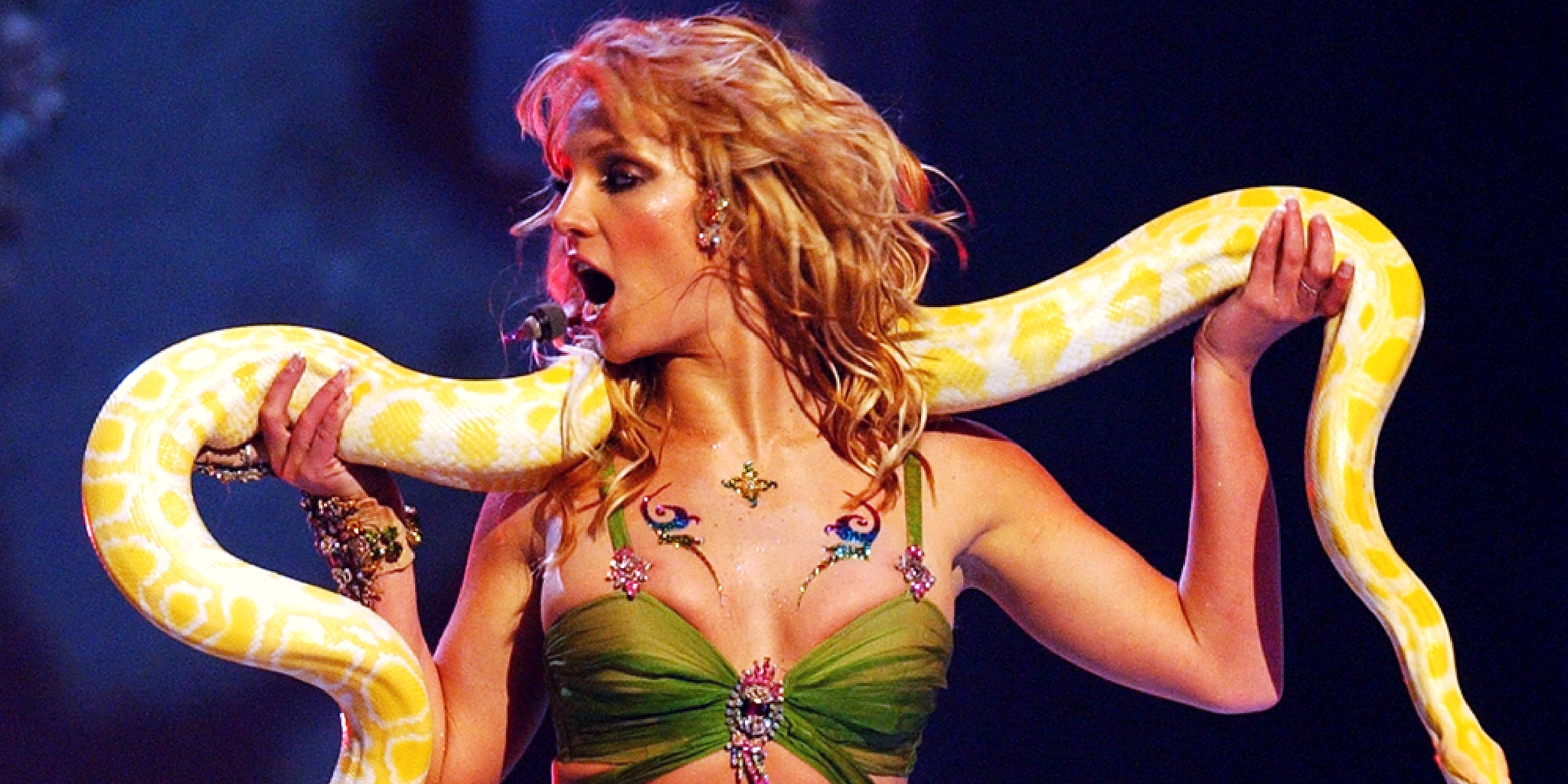 Britney Spears dacing with yellow snake